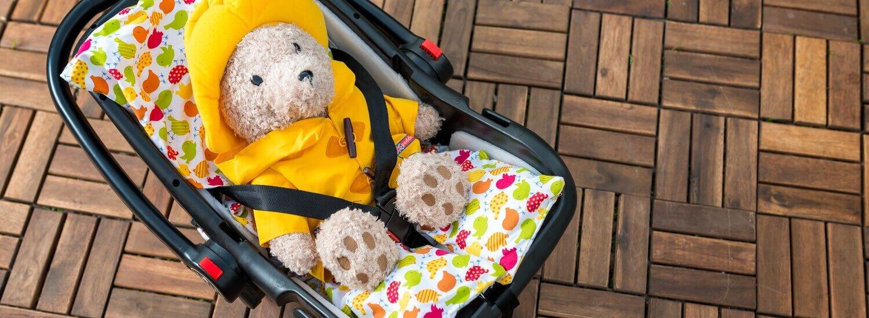 Podloga za otroka za v avtosedež, voziček ali lupinico polnjena s pirinimimi luščinami.